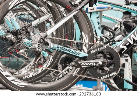 CAMBERLEY, UK - SEPTEMBER 13: High-tech Omega Pharma Quick-step team bikes before a stage of the Tour of Britain from Camberley, UK on September 13, 2014 - stock photo