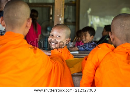 CAMBODIA - AUGUST 11 : Portrait of youth monks in Buddhism at Siem Leap province, Cambodia on August 11,  2014. - stock photo