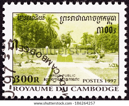 "CAMBODIA - CIRCA 1997: A stamp printed in Cambodia from the ""Public Gardens and Tuk Chha Canal  "" issue shows Statue at intersection of paths, circa 1997."