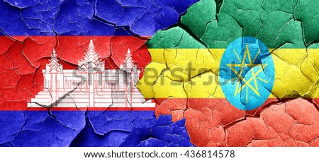 Cambodia flag with Ethiopia flag on a grunge cracked wall - stock photo