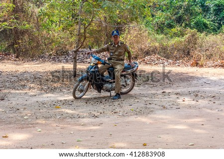 CAMBODIA, SIAM REAP - MARCH 22, 2016: Motorcycle cop  - stock photo