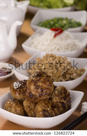 Cambodian Banchao; Grilled Pork Patties typically served with vegetables, rice vermicelli, condiments, fish sauce and sometimes, a broth. Unsharpened File