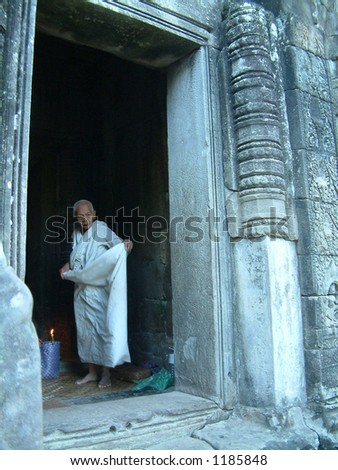 Cambodian priestess in temple - stock photo