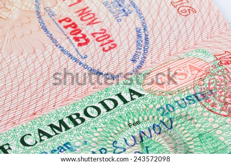Cambodian visa stamp in foreign passport sheet - stock photo