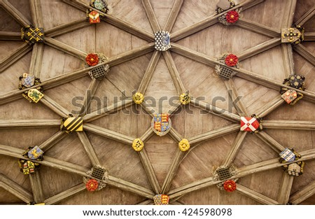 CAMBRIDGE, ENGLAND - MAY 9, 2015: The stone ceiling of the entryway of Trinity College at Cambridge, England is filled with insignia and family crests that represent the history of the building. - stock photo