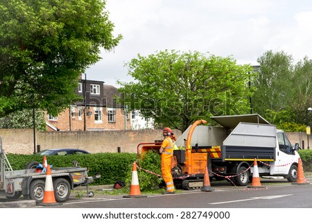 CAMBRIDGE, ENGLAND - 7 May 2015: Tree Surgeons at work in public car park in Cambridge, England
