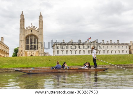 CAMBRIDGE, UK - JULY 24, 2015: Punting in summer on the river Cam with the view of King's College of the University of Cambridge in the background. - stock photo