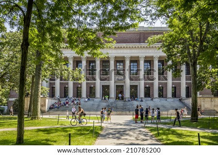 CAMBRIDGE, USA - JUNE 2: Panorama of the Harvard University's campus in Cambridge, MA, USA showcasing its historic architecture, gardens and students passing by on June 2, 2014. - stock photo