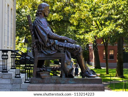 CAMBRIDGE, USA - SEPTEMBER 14, 2012: John Harvard's statue in the Harvard's campus in Cambridge, MA, is the third most photographed monument in the USA. Photographed as it is on September 14, 2012.