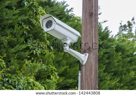 camcorder monitor on top of a pole - stock photo