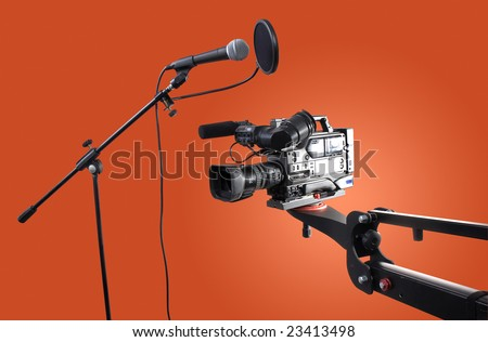camcorder on crane and microphone - stock photo