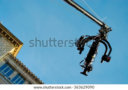 Camcorder work. The camera on the operator crane. - stock photo