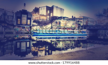 Camden lock with a canal boat moored with a instagram type filter - stock photo