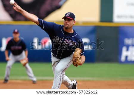 CAMDEN, NJ - JULY 15: Somerset Patriots pitcher Josh Miller releases a pitch during the game on July 15, 2010 in Camden, NJ. - stock photo