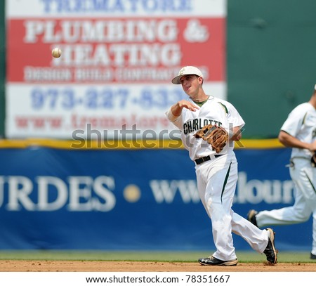 CAMDEN, NJ - MAY 26: Charlotte infielder Corey Shaylor throws the ball to first base during an Atlantic Ten baseball tournament game against Richmond May 26, 2011 in Camden, NJ. - stock photo