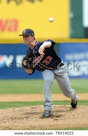 CAMDEN, NJ - MAY 26: Charlotte pitcher Bret Williams delivers a pitch during an Atlantic Ten baseball tournament game against Richmond on May 26, 2011 in Camden, NJ. - stock photo