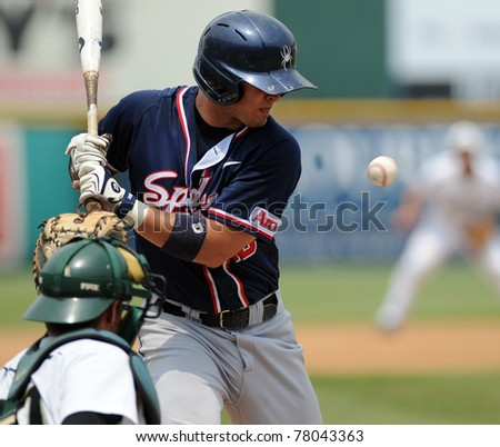 CAMDEN, NJ - MAY 26: Richmond baseball player Jacob Mayers (blue) braces just before being hit by a pitch during an Atlantic Ten baseball tournament game against Charlotte on May 26, 2011 in Camden, NJ. - stock photo