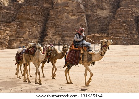 Camel caravan traveling in Wadi Rum,Jordan - stock photo