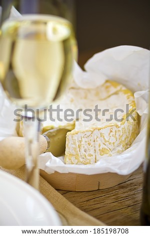 Camembert cheese and glass of white dry wine, shallow dof, selective focus  - stock photo