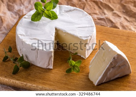 Camembert cheese on a rustic background - stock photo