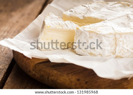 camembert cheese slice macro shot. Shallow DOF - stock photo