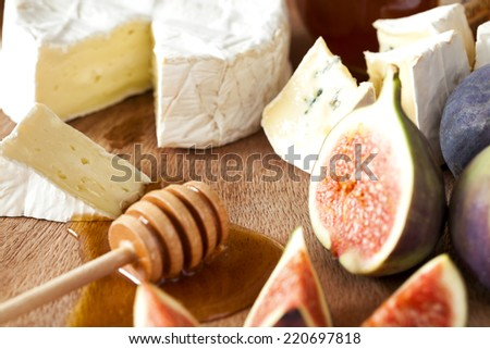 camembert cheese with figs and honey - stock photo