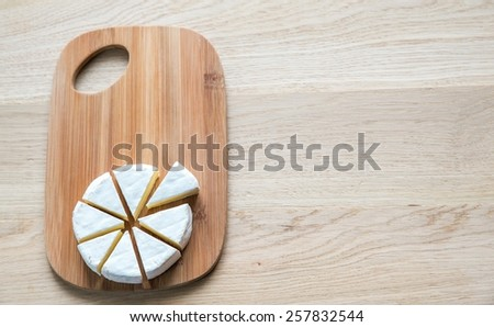 Camembert on the wooden board - stock photo