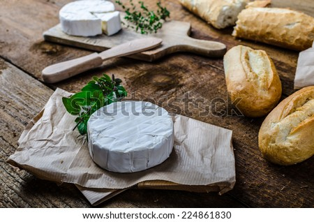 Camembert, soft cheese with homemade pastries, old school - stock photo