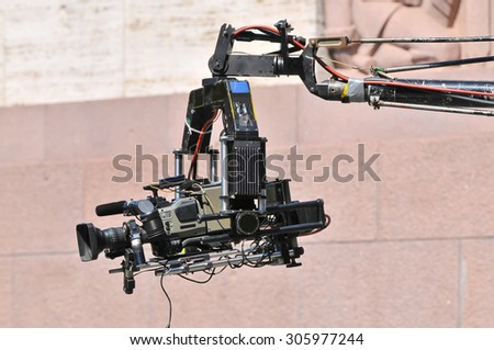 Camera crane in action - stock photo