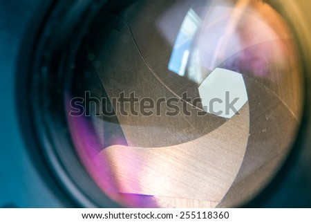 Camera diaphragm aperture with window reflection flare and reflection on lens