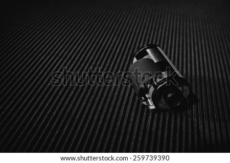 Camera film roll design on blue background, black and white picture  - stock photo