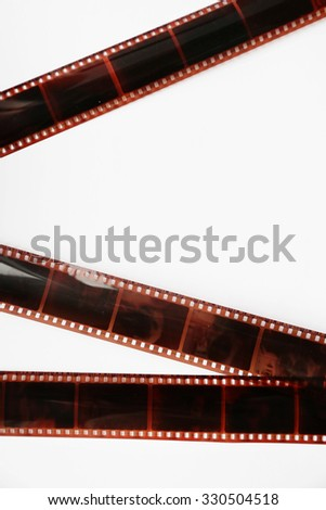 Camera film strips on white background - stock photo
