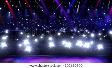 camera flash in concert with spotlight - stock photo