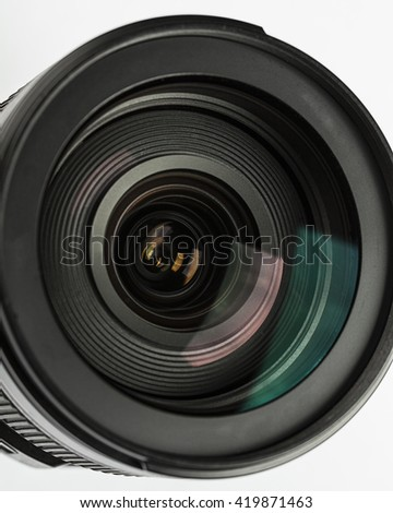 Camera lens close-up on white background