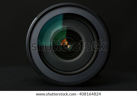 Camera Lens on the black background - stock photo