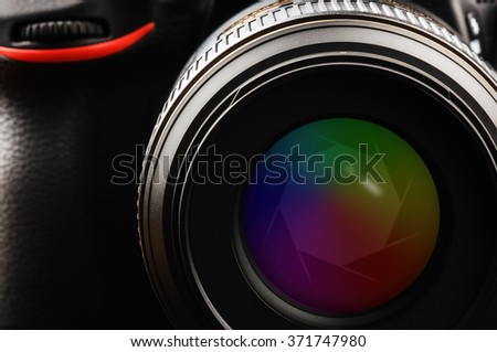 Camera lens with shutter. Closeup shot - stock photo