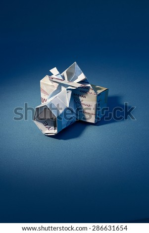Camera made of folded Hundred Turkish Lira - stock photo
