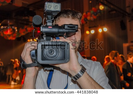 Camera man front lens ball dancing college night club young students - stock photo