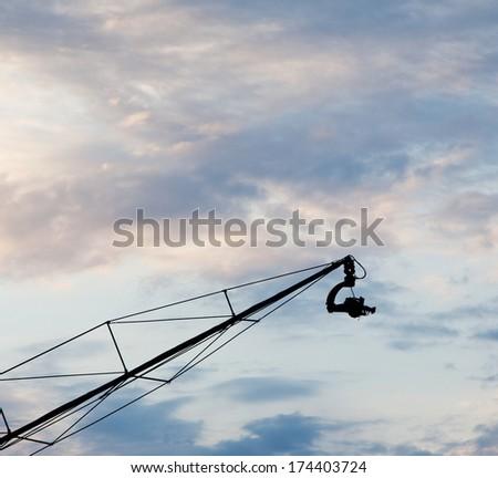 Camera on long crane - stock photo