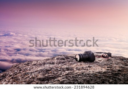 camera on the stone and cloud sky - stock photo