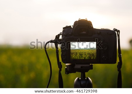 Camera on tripod capturing landscape