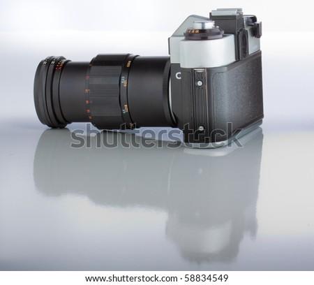 Camera on white background - stock photo