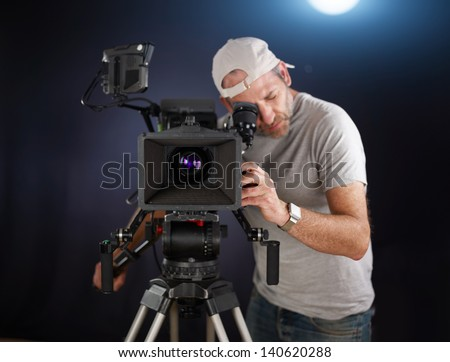 camera operator working with a broadcast camera - stock photo