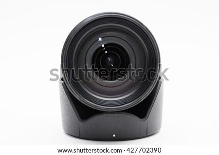 Camera photo lens over white background - stock photo