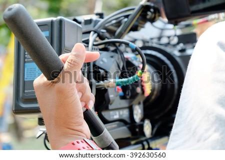 Cameraman at work,Professional digital video camera  - stock photo