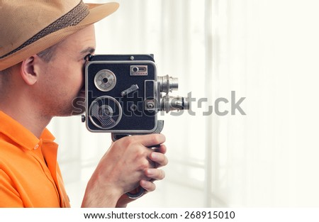 cameraman make film on a retro camera - stock photo