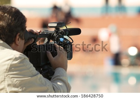 cameraman over blurry background - stock photo