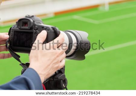 Cameraman recording sports event. - stock photo
