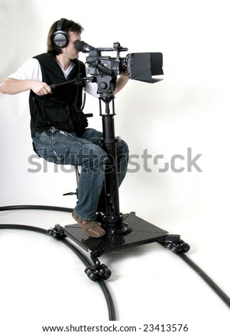 cameraman work with HD camcorder on the dolly - stock photo