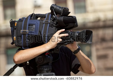 Cameraman working in the street